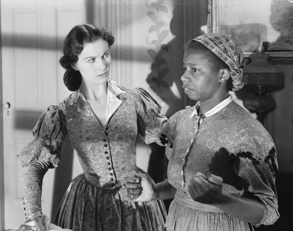 British actress Vivien Leigh with Butterfly McQueen in a scene from the American civil war epic 'Gone With the Wind'.  (Photo via John Kobal Foundation/Getty Images)
