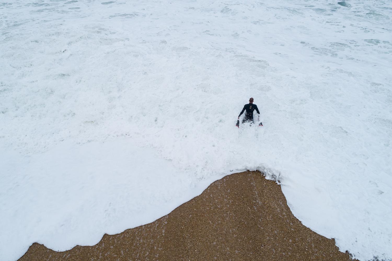 Kalani Lattanzi stands in the ocean