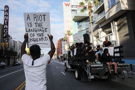 A man protests police brutality in Los Angeles