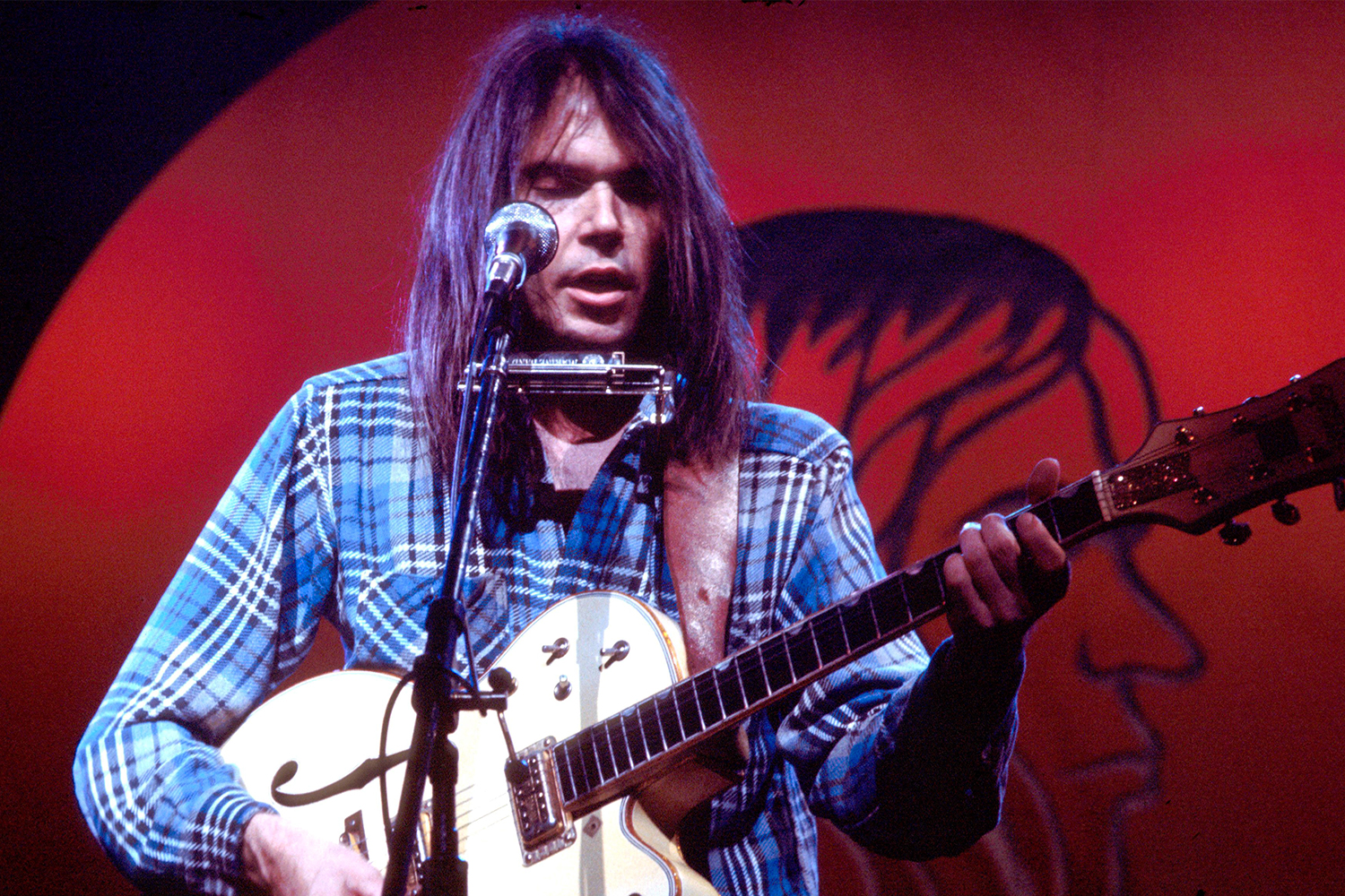 Neil Young performs on stage at Hammersmith Odeon, London, 28th March 1976