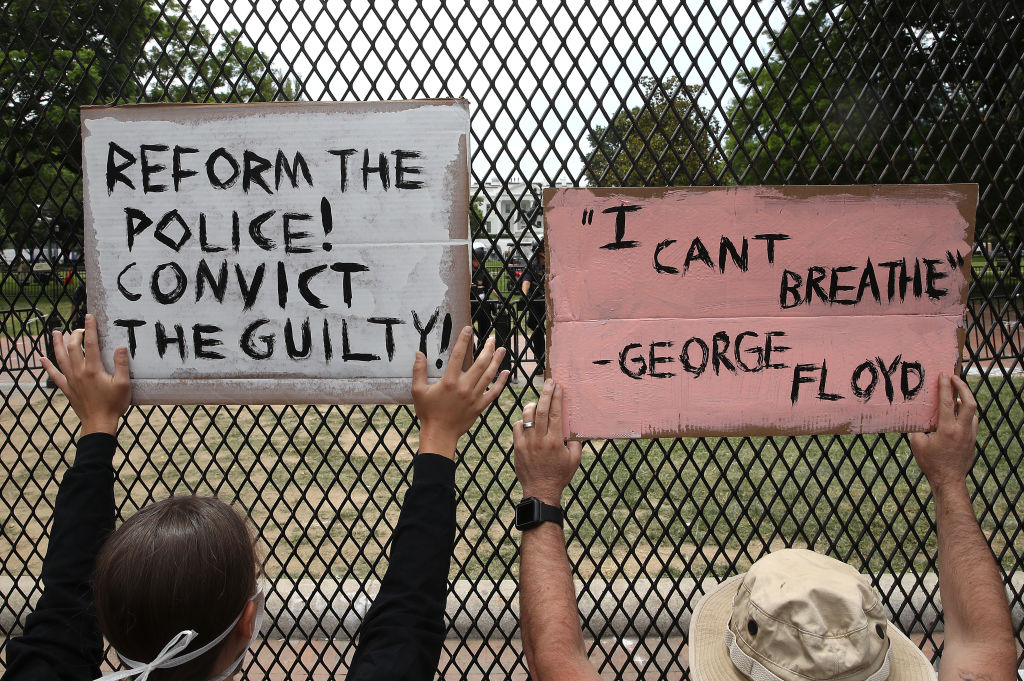 Two people protesting near the White House
