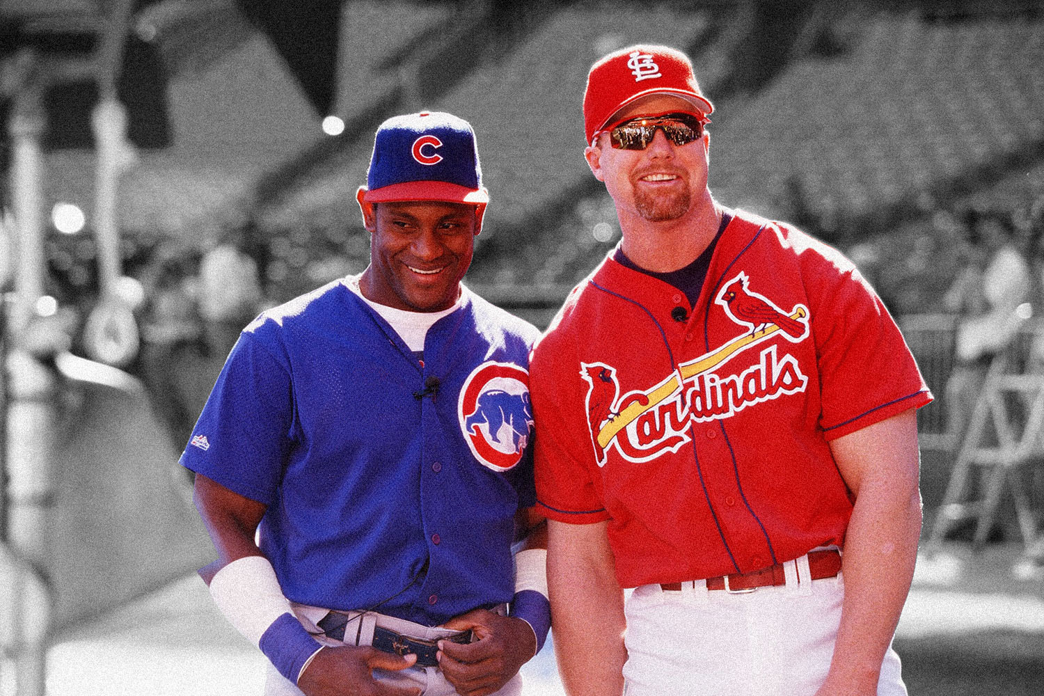 Mark McGwire of the St. Louis Cardinals and Sammy Sosa of the Chicago Cubs joke before the game at Busch Stadium on September 7, 1998 in St. Louis, Missouri. (Photo by Sporting News via Getty Images via Getty Images)