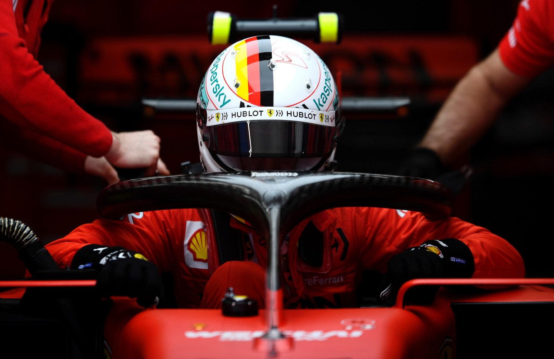 Sebastian Vettel sits in his car before a race