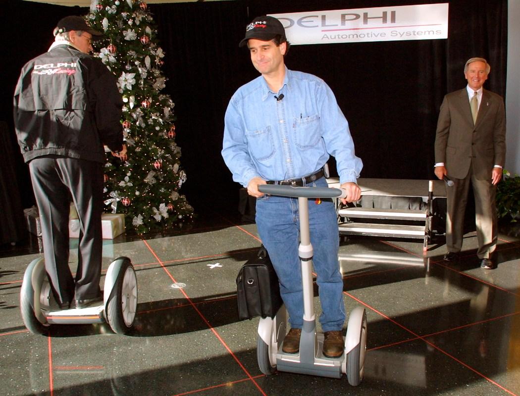 Segway inventor Dean Kamen demonstrates the futuristic scooter in December 2001