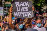 A participant holding a Black Lives Matter sign at the