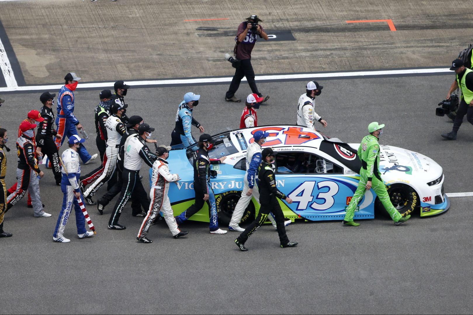 NASCAR Drivers Support Bubba Wallace By Pushing Car to Front