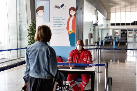Wearing a face mask at an airport