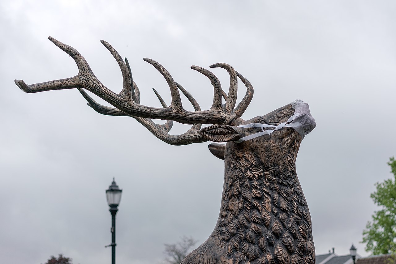 Elk statue with facemask