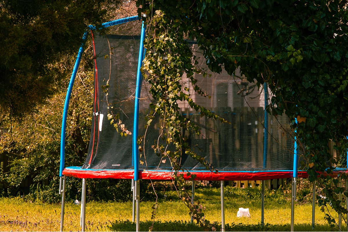 Trampoline in a backyard