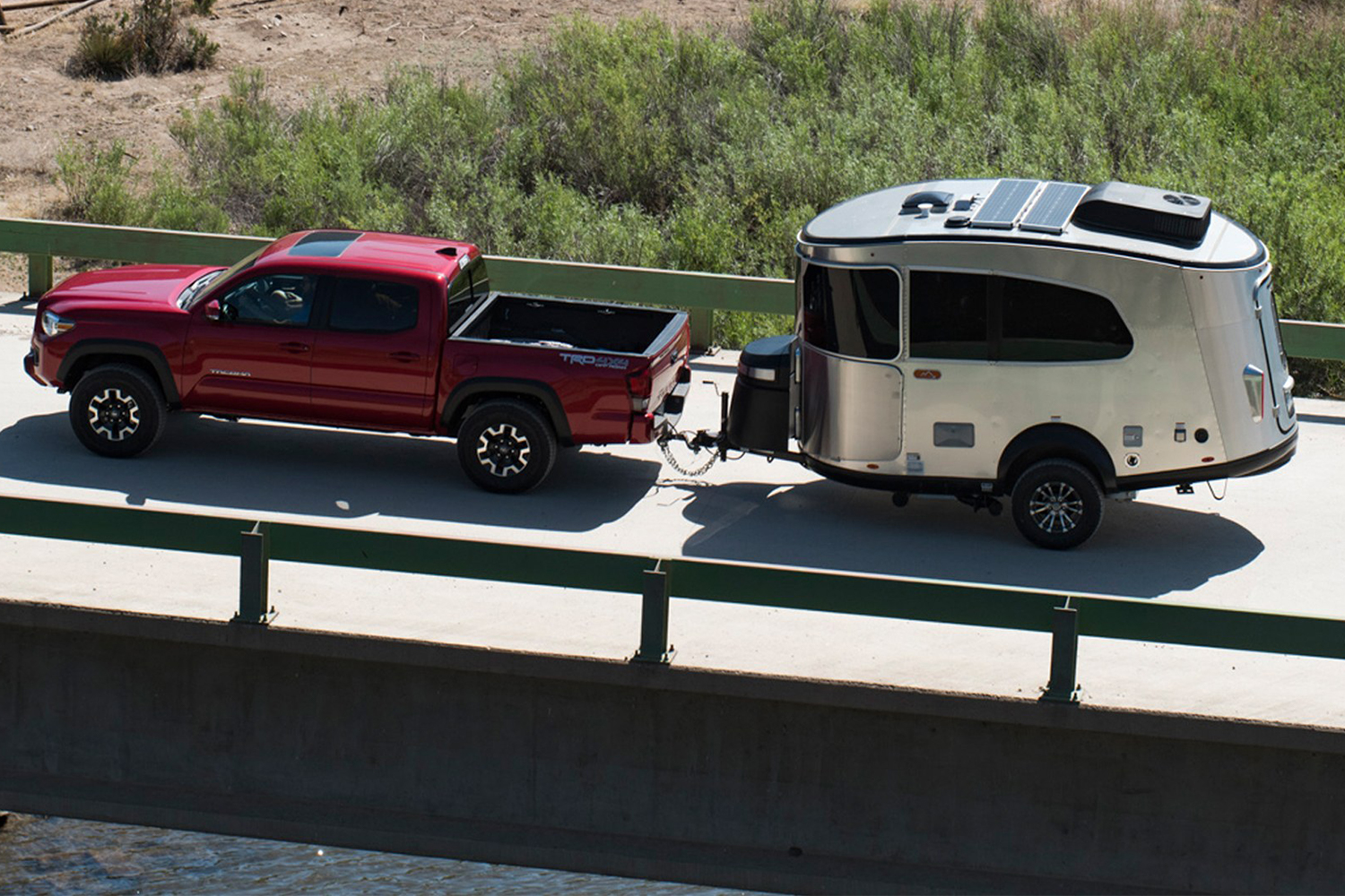 Airstream Basecamp trailer being towed behind a pickup truck