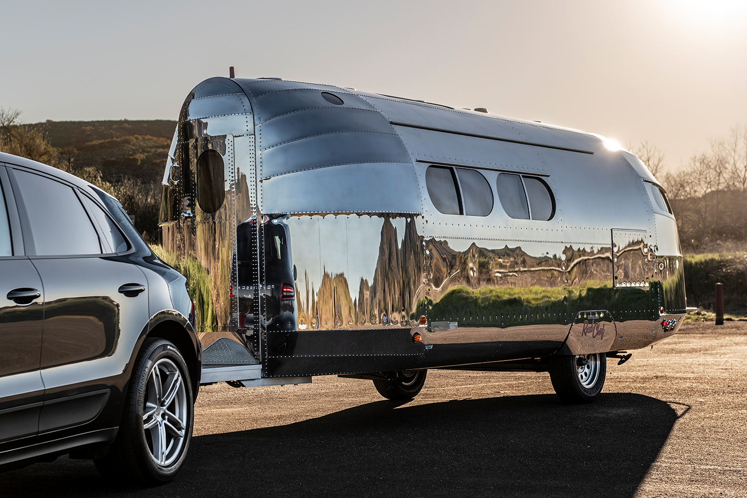 Bowlus Road Chief aluminum trailer being pulled by an SUV