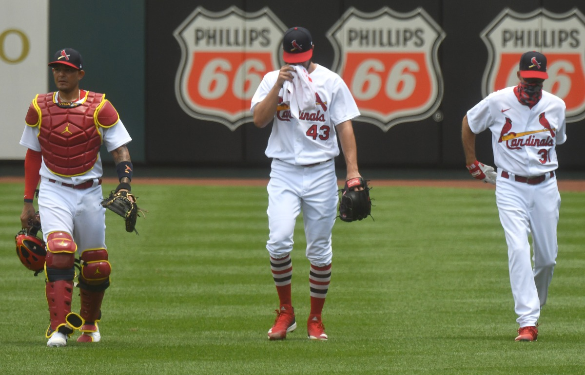 From left, St. Louis Cardinals catcher Yadier Molina, starting pitcher Dakota Hudson and pitching coach Mike Maddox make their way to the dugout after warming up before a Major League Baseball game between the Pittsburgh Pirates and the St. Louis Cardinals, on July 26, 2020, at Busch Stadium, St. Louis, MO. (Photo by Keith Gillett/Icon Sportswire via Getty Images)