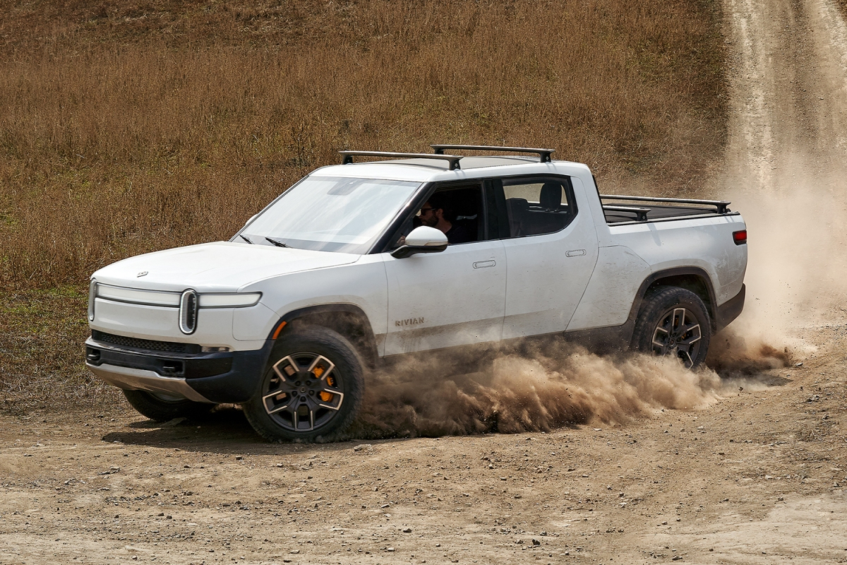 Rivian R1T electric pickup truck driving in the dirt