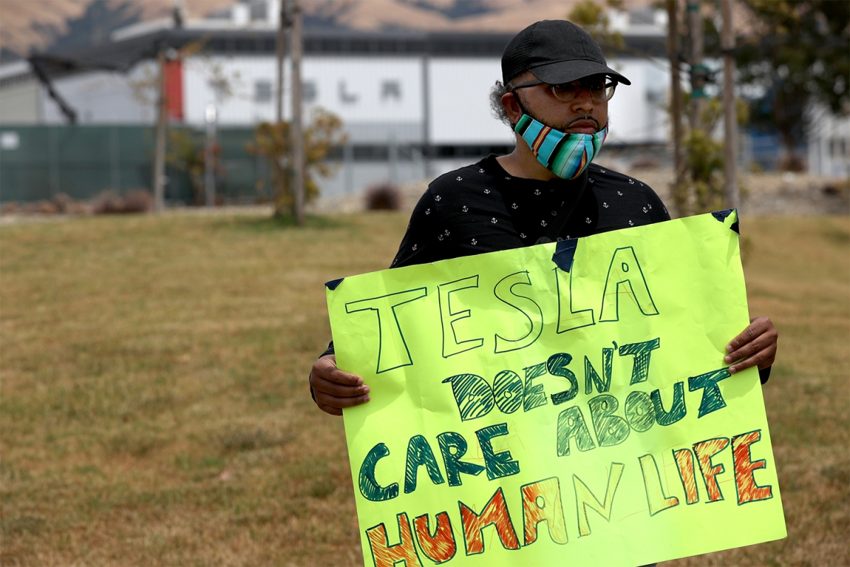 Former Tesla employee Carlos Gabriel protesting outside the Fremont factory on June 15.
