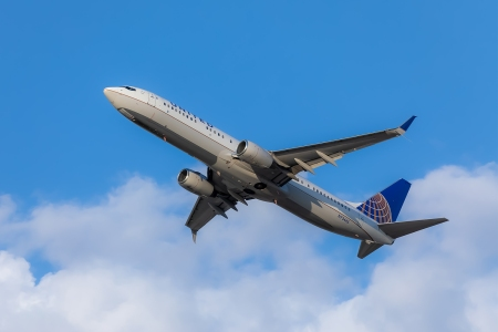 United Airlines airplane flying in a blue sky