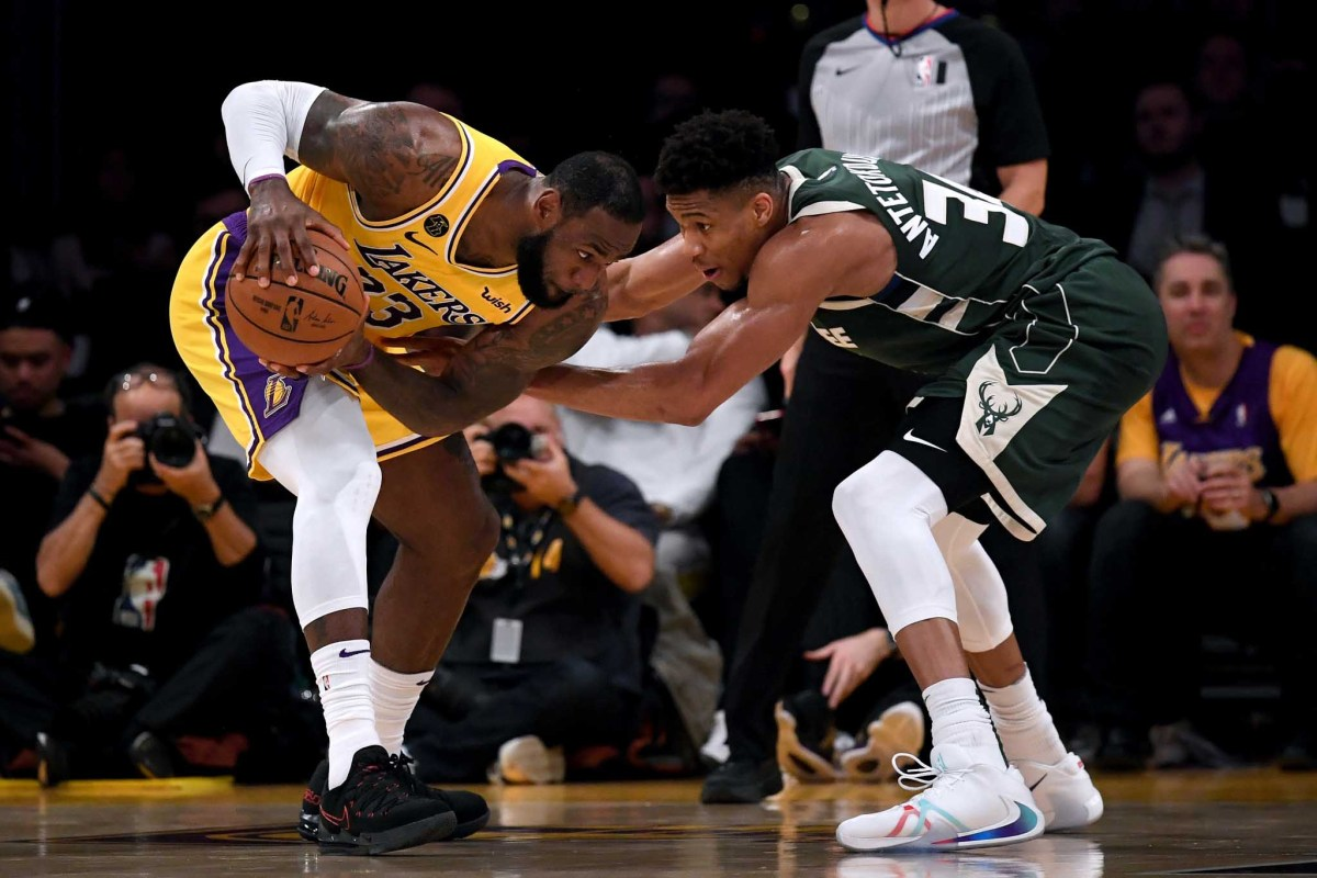LeBron James is guarded by Giannis Antetokounmpo during the third quarter at Staples Center on March 06, 2020