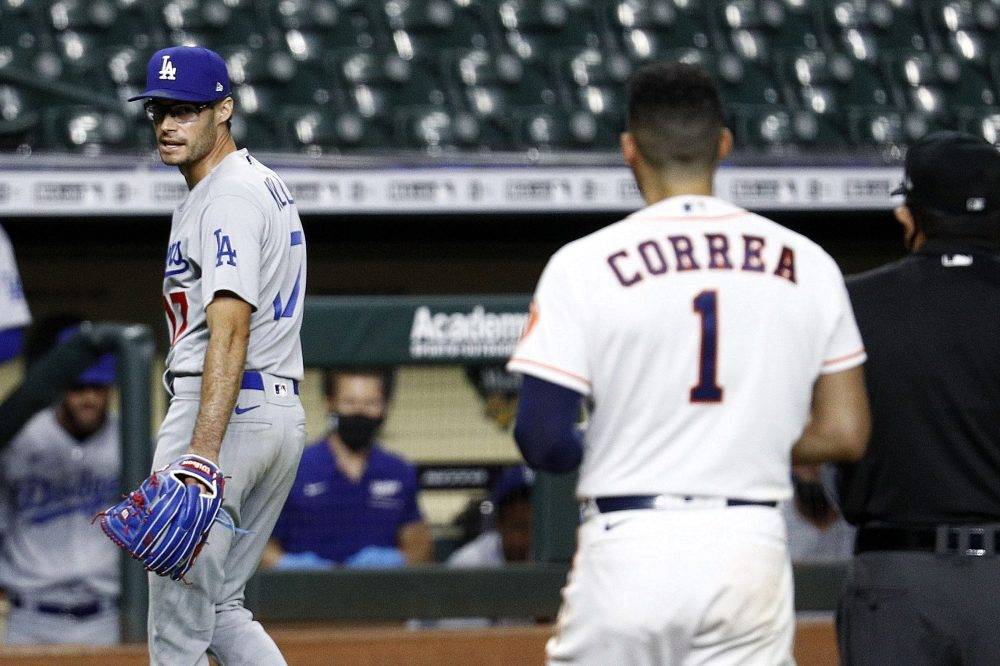 Joe Kelly of the Dodgers has a word with Carlos Correa of the Astros. (Bob Levey/Getty)