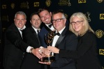 Ellen DeGeneres show executives posing with a Daytime Emmy award
