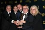 Ellen DeGeneres show executives posing with a Daytime Emmy award