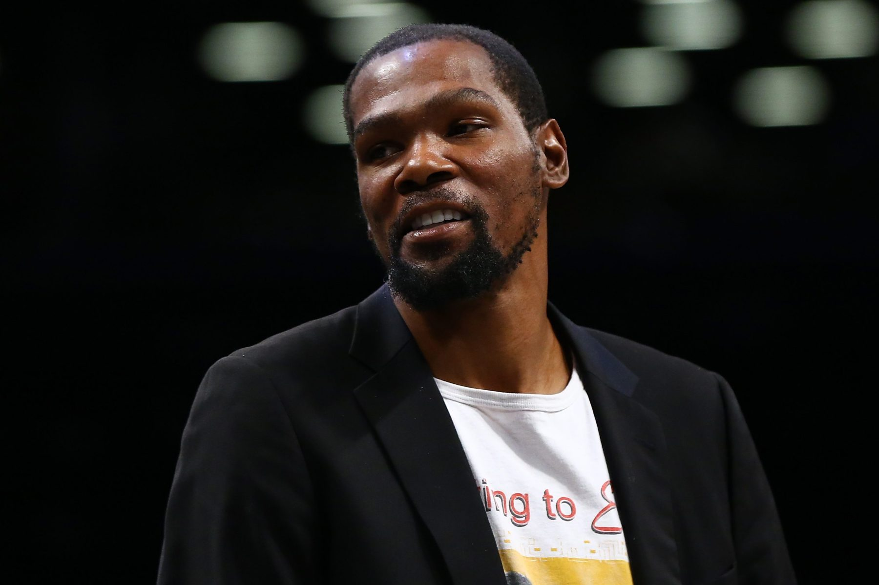 Kevin Durant of the Brooklyn Nets looks on from the bench in February. (Mike Stobe/Getty)