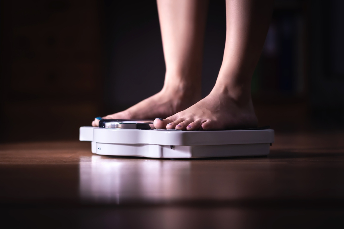 Person standing on a scale