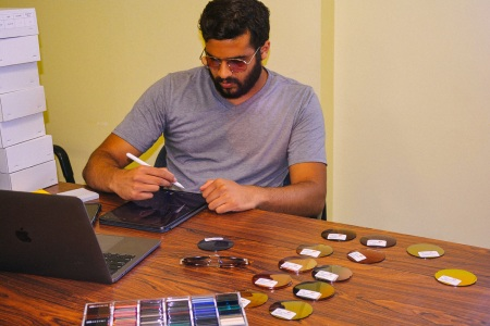 Akshar H. Patel of sunglasses company Bold Dots working at his desk
