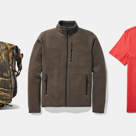 A Filson x Mossy Oak collab duffel bag, fleece jacket and graphic T-shirt
