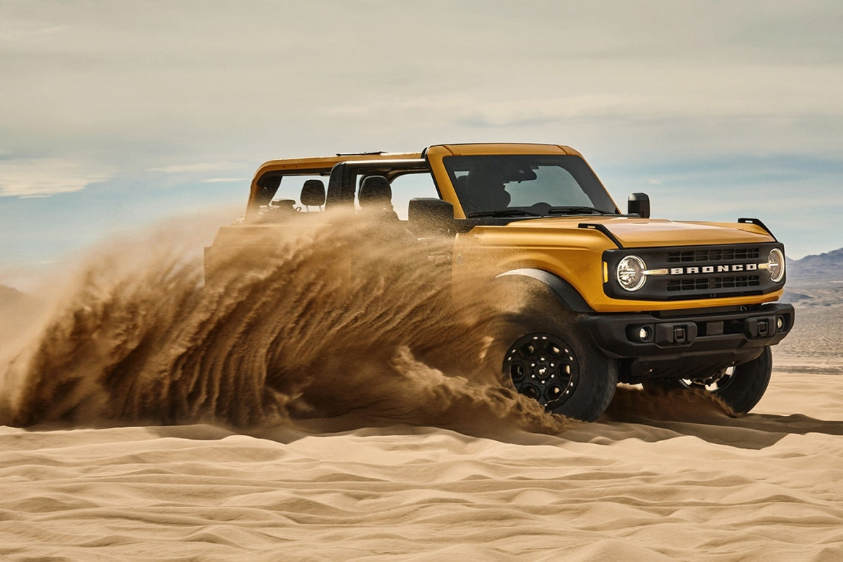 yellow 2021 Ford Bronco SUV driving in the sand
