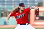 Starting pitcher Mike Clevinger of the Cleveland Indians pitches against the Cincinnati Reds during the first inning at Progressive Field on August 05, 2020 in Cleveland, Ohio. (Photo by Ron Schwane/Getty Images)
