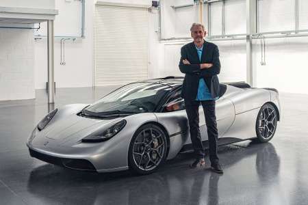 Gordon Murray standing next to his new supercar the T.50