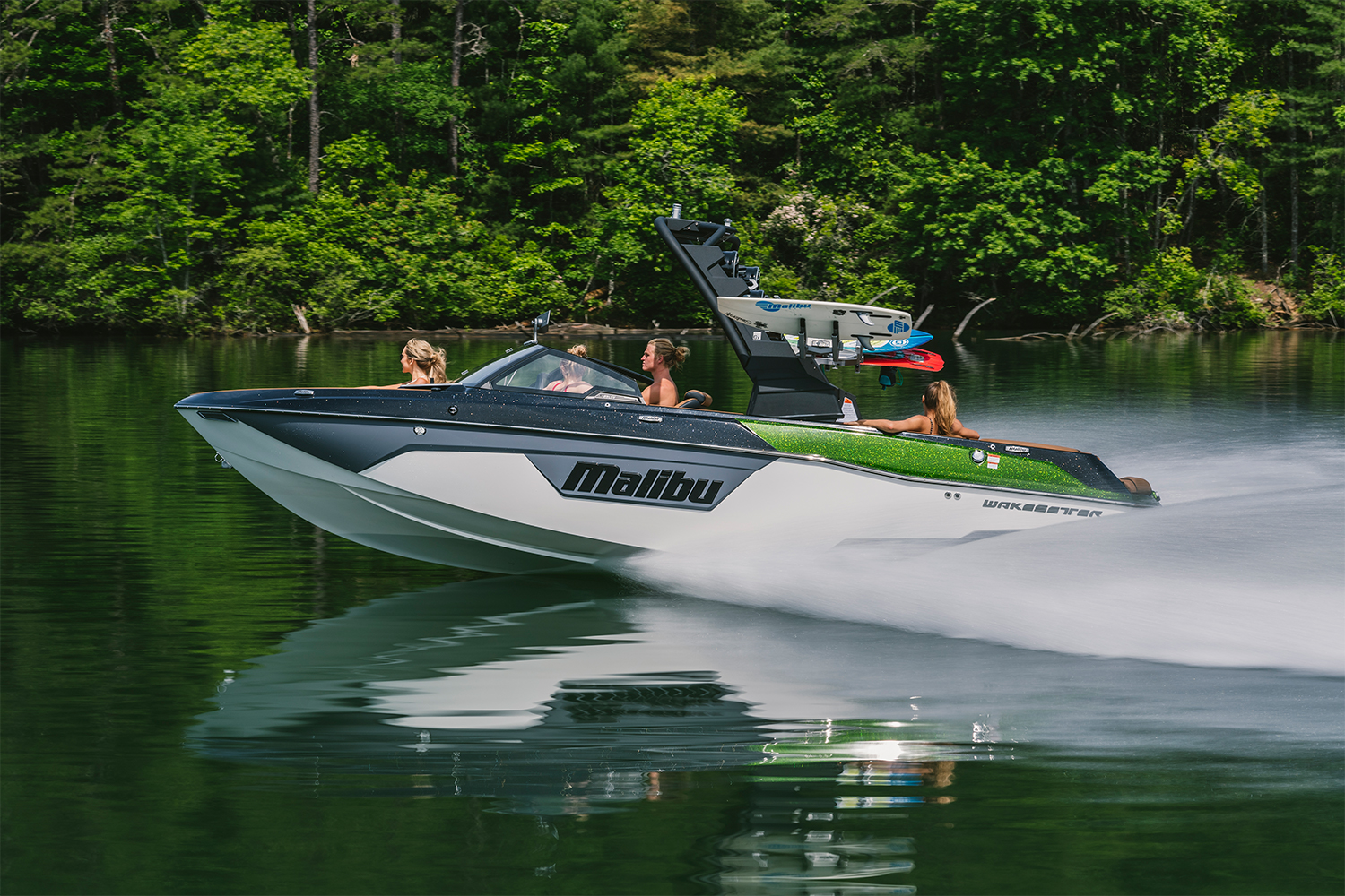 The 2021 Malibu Boats 23 LSV wakesetter towboat speeding across a lake