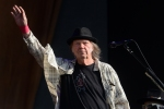 Neil Young performs on stage in Hyde Park on July 12, 2019 in London, England