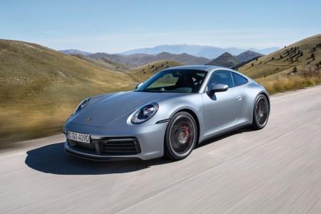 2018 Porsche 911 Carrera 4S sports car in silver driving through the hills