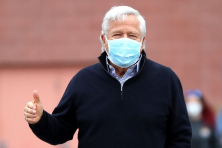 New England Patriots owner Robert Kraft gives a thumbs up, un-related to his court case.