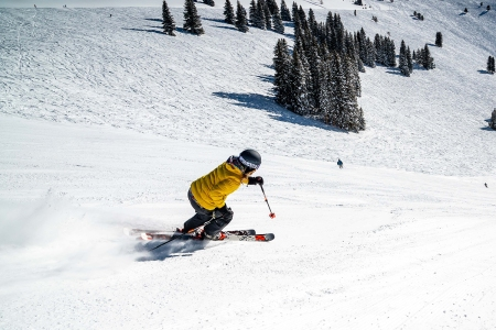 Skier in yellow skiing down a mountain in Vail, Colorado