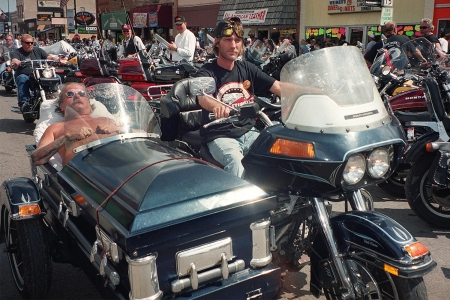 Two bikers at Sturgis in South Dakota in 2001, one in a coffin sidecar
