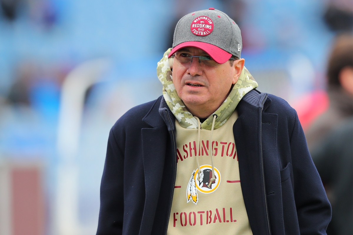 Washington Football Team owner Dan Snyder on the field before a game in November 2019