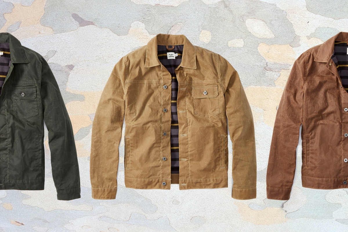 Three different colors of Flint and Tinder's men's flannel-lined waxed trucker jacket