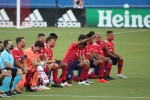 FC Dallas players kneel during the national anthem