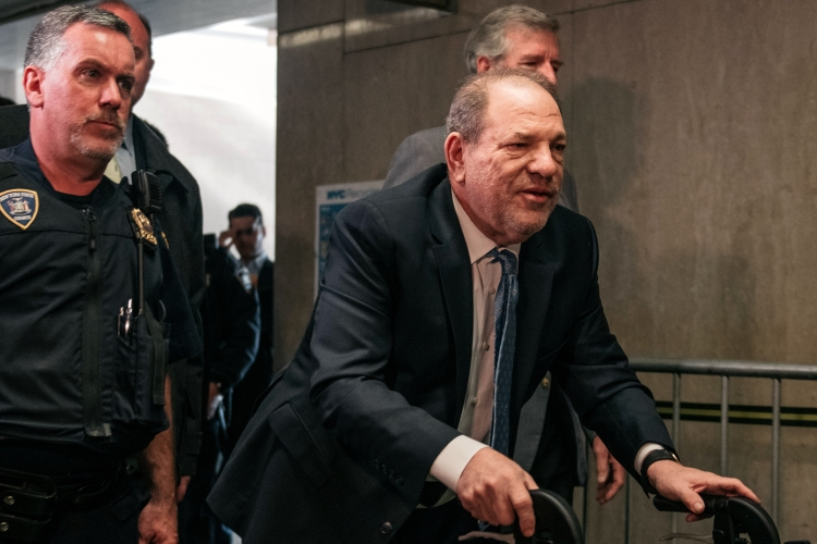 Harvey Weinstein using a walker