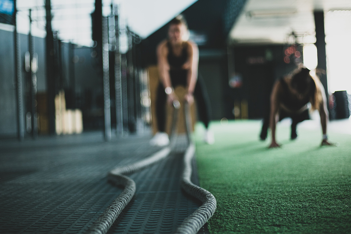 Athlete in the gym holding battle ropes