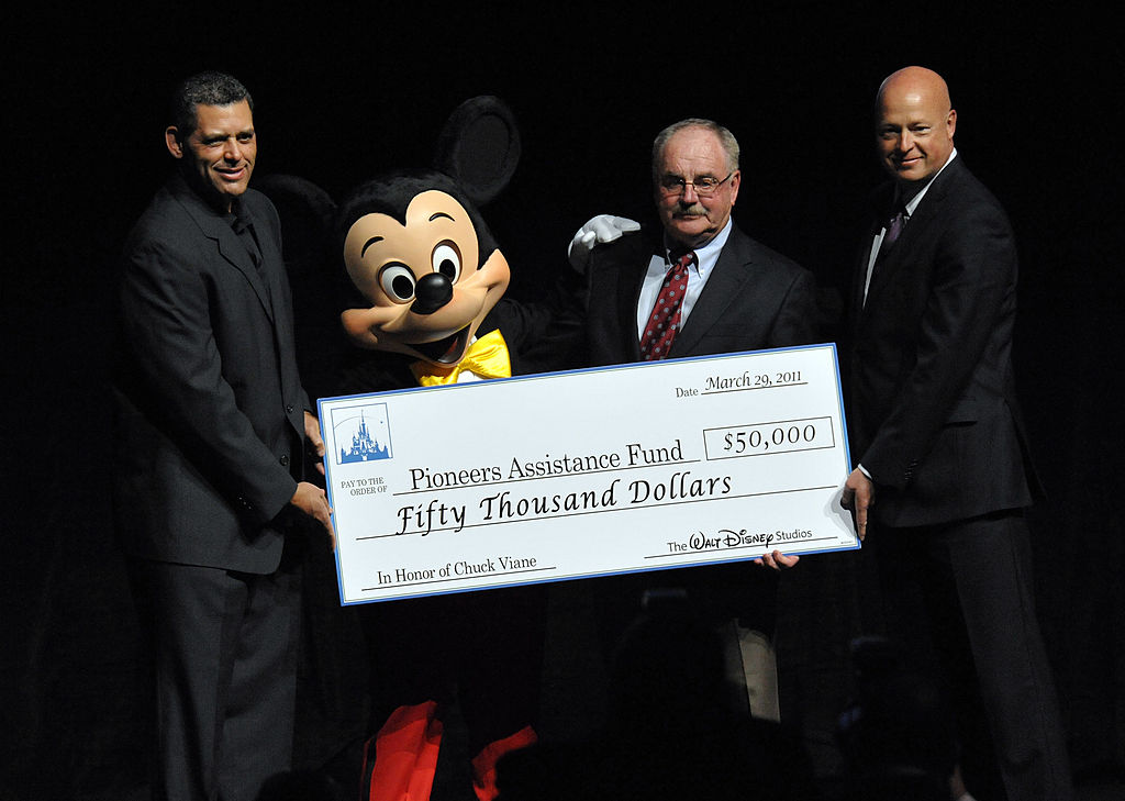 Executive Director of Will Rogers Motion Pictures Pioneers Foundation Todd Vradenburg, Mickey Mouse, Chairman the Will Rogers Motion Picture Pioneers Foundation Chuck Viane, and The Walt Disney Studios president of Distribution Bob Chapek attend the CinemaCon, the official convention of the National Association of Theatre Owners, at The Colosseum of Caesars Palace on March 29, 2011 in Las Vegas, Nevada.