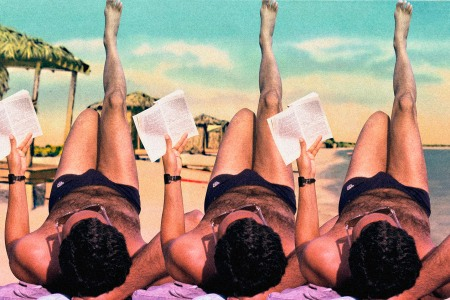 Man reading on the beach during summer