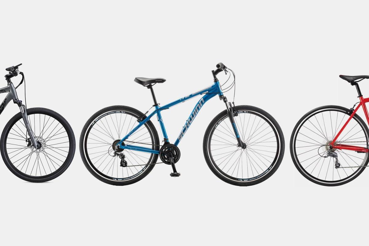 Three bicycles including an electric bike, hybrid bike and road bike