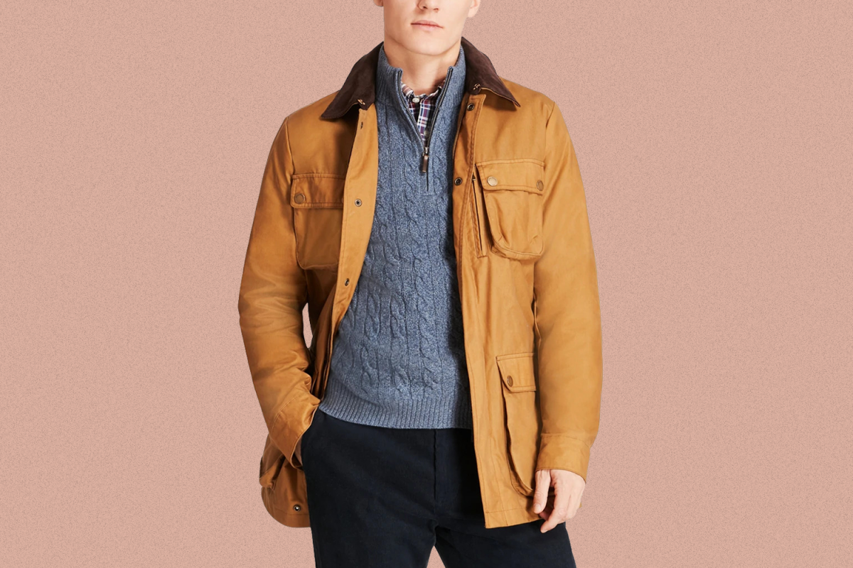 A man wearing a waxed field jacket from Brooks Brothers