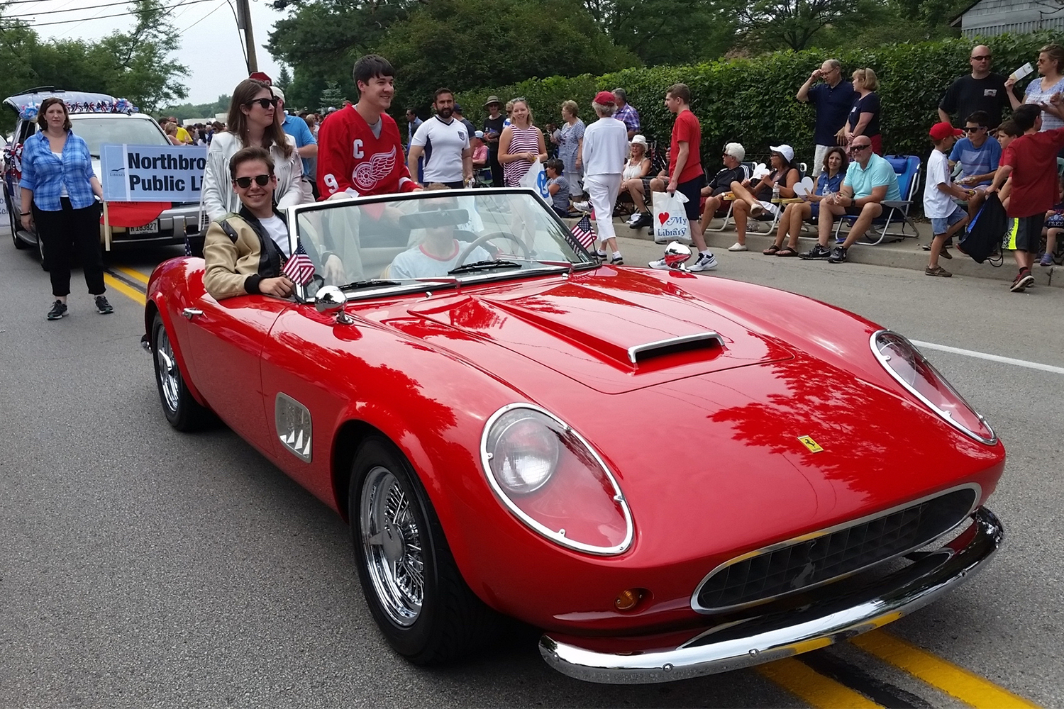 1961 Ferrari 250 GT California replica with people dressed like Ferris Bueller's Day Off characters