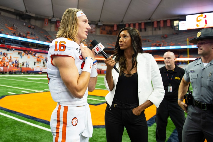 ESPN's Maria Taylor interviews Clemson Tigers Quarterback Trevor Lawrence (16) after the game between the Clemson Tigers and the Syracuse Orange on September 14, 2019, at the Carrier Dome in Syracuse, NY. (Photo by Gregory Fisher/Icon Sportswire via Getty Images)