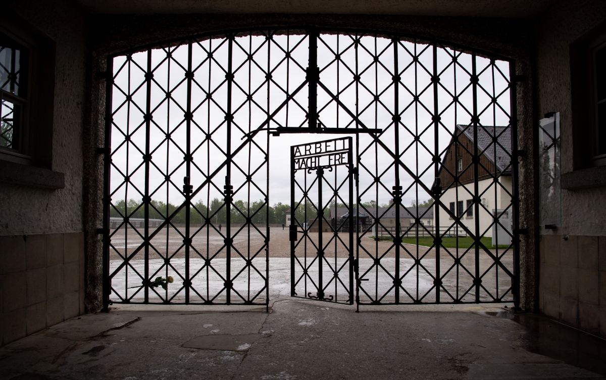 "The entrance gate with the inscription ""Arbeit macht frei"" can be seen at the Dachau concentration camp memorial site. US soldiers liberated more than 30,000 people imprisoned in the camp on April 29, 1945. (Photo by Sven Hoppe/picture alliance via Getty Images)"