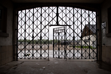 """The entrance gate with the inscription """"Arbeit macht frei"""" can be seen at the Dachau concentration camp memorial site. US soldiers liberated more than 30,000 people imprisoned in the camp on April 29, 1945. (Photo by Sven Hoppe/picture alliance via Getty Images)"""