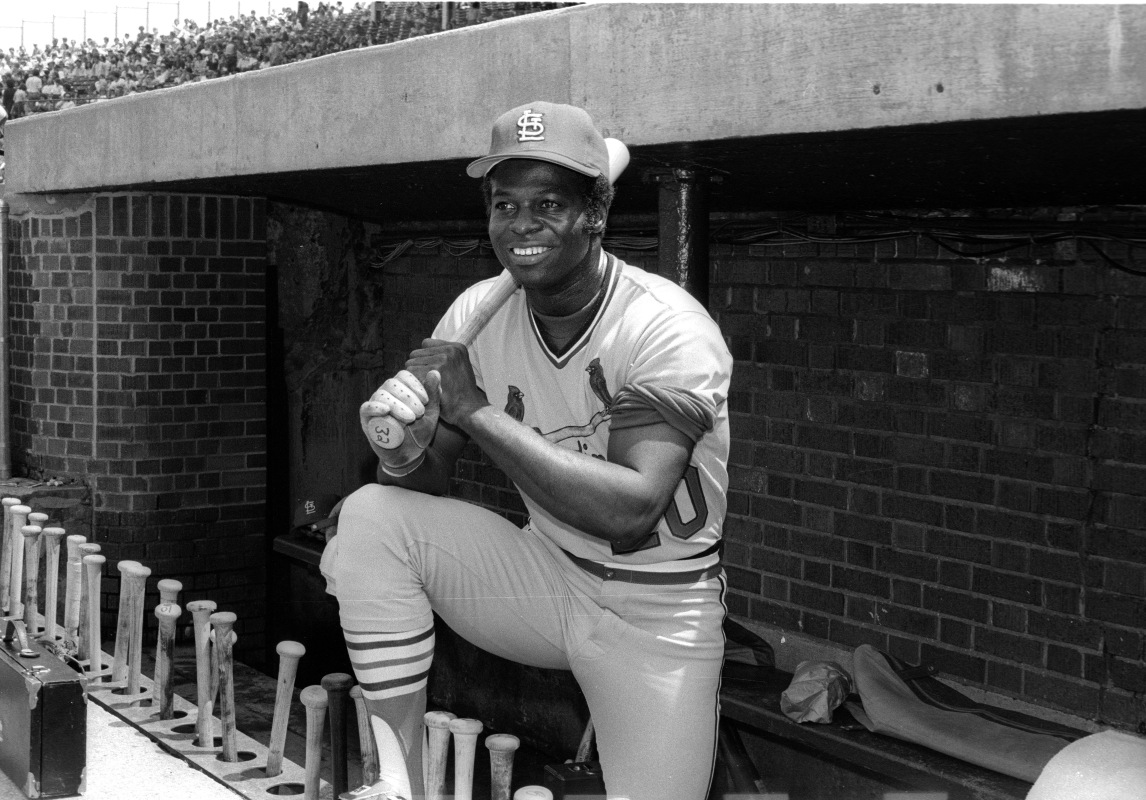 Lou Brock poses in the dugout.